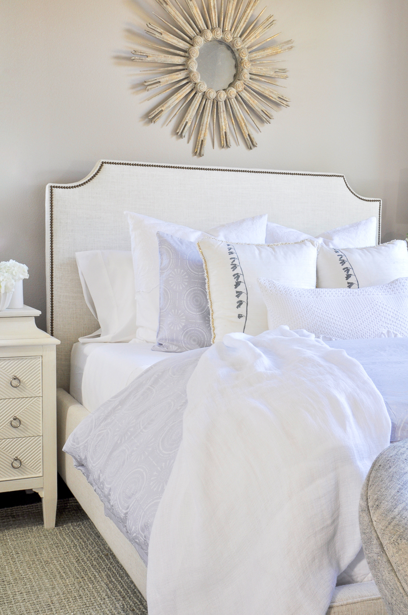 beautiful layered bed with white bedding and white sheets