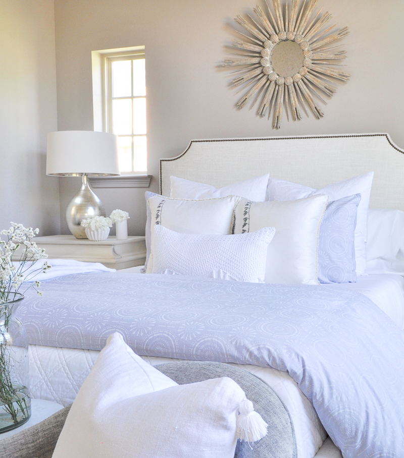 beautiful layered bed with white bedding white sheets