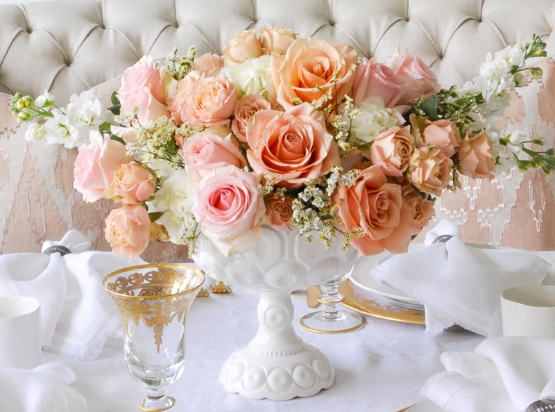 beautiful spring floral arrangement with roses in peach and pink