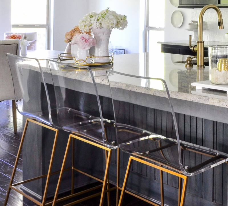 gorgeous lucite and gold barstools in kitchen update
