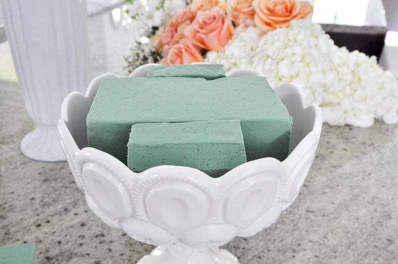green wet foam in pedestal dish for flower arrangement