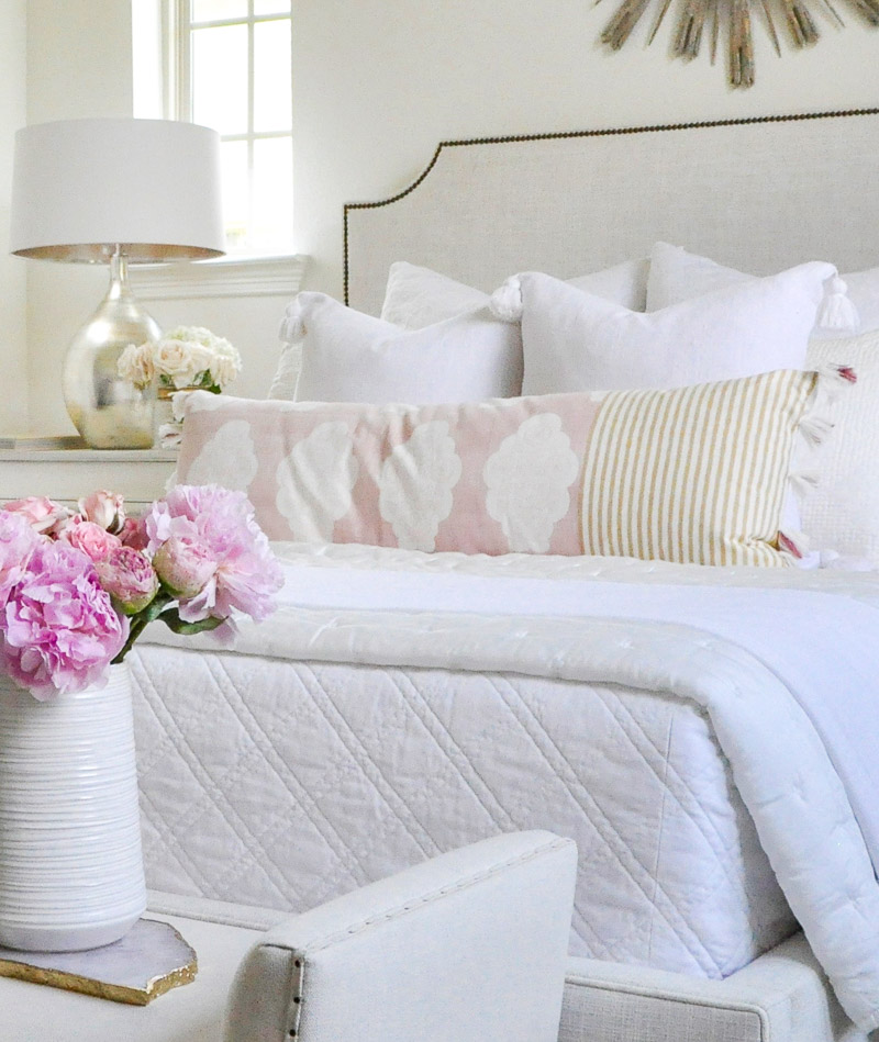 white guest bedroom blush accents
