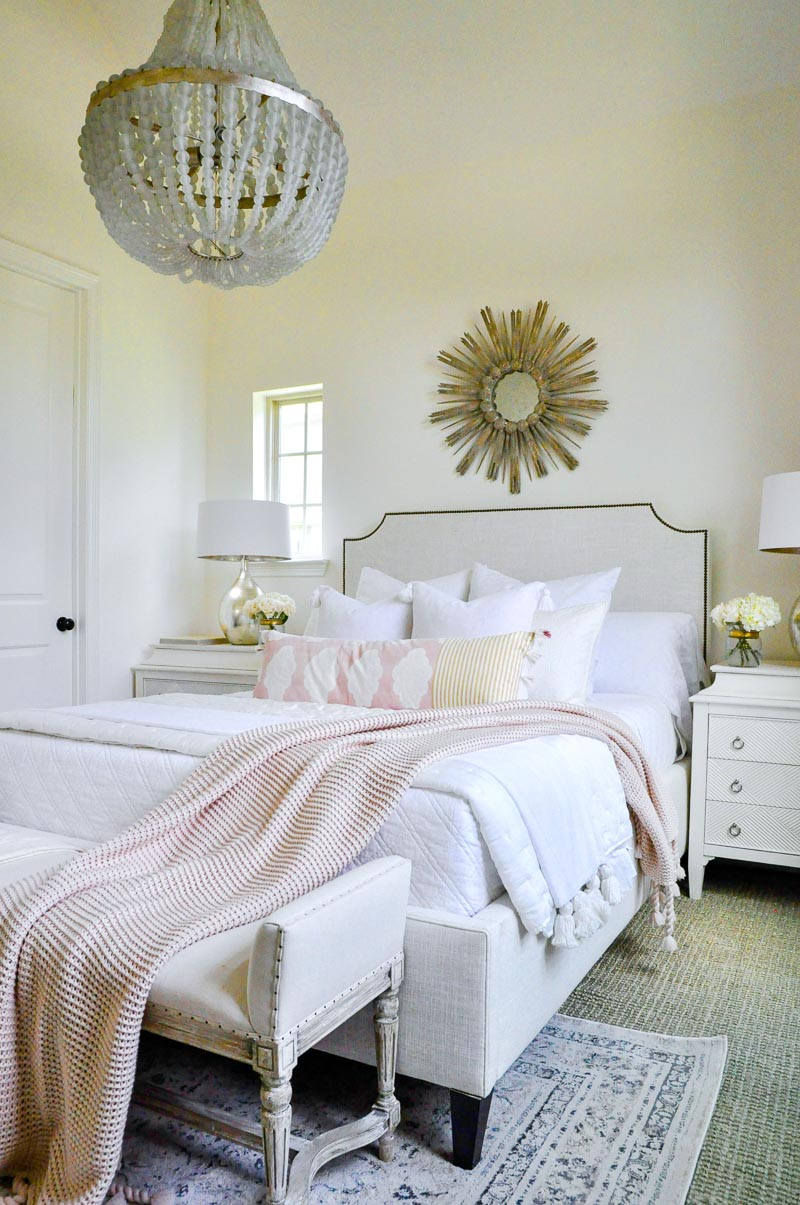 Dreamy white bedroom blush accents