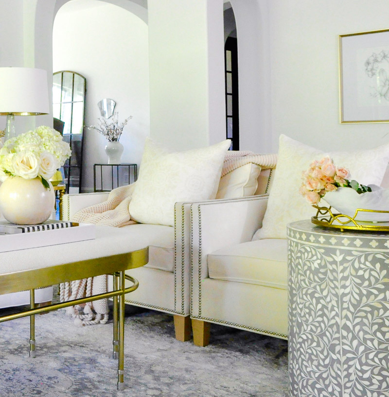 White chairs while pillows