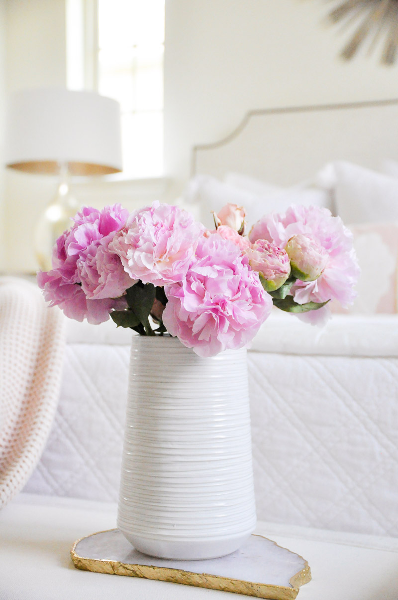 White vase pink peonies