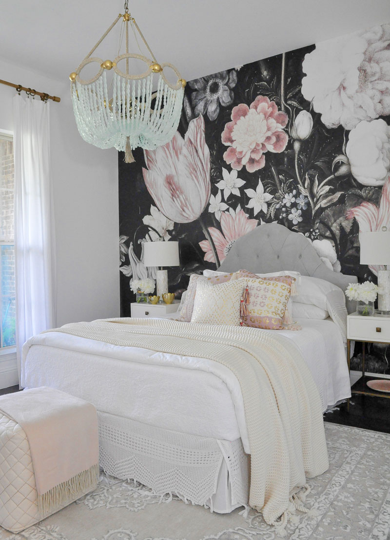 Beautiful bedroom white bedding pink pillows dark floral wallpaper
