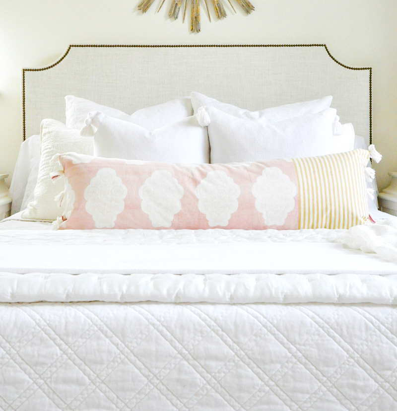 beautiful white layered bedding