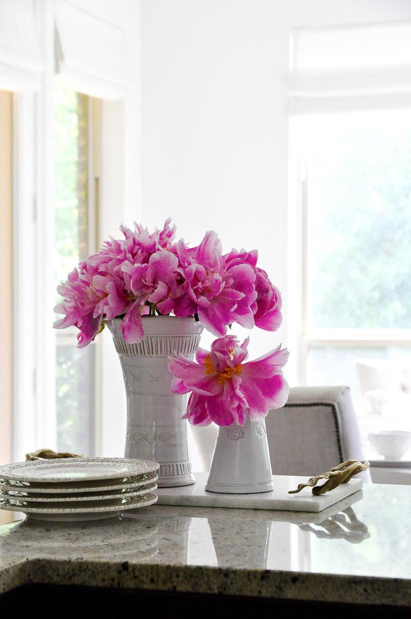 White vase bright pink peonies