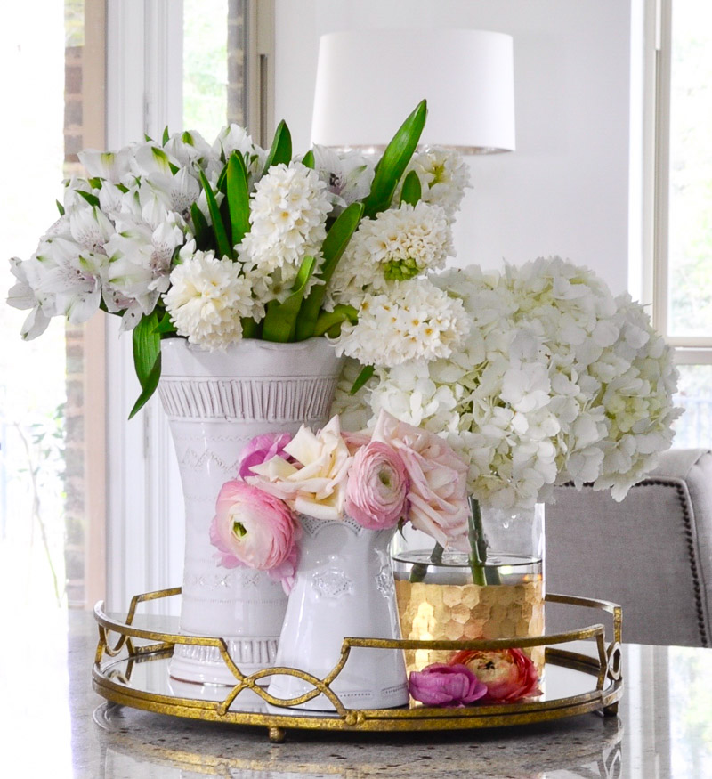 Beautiful round gold tray holding vases