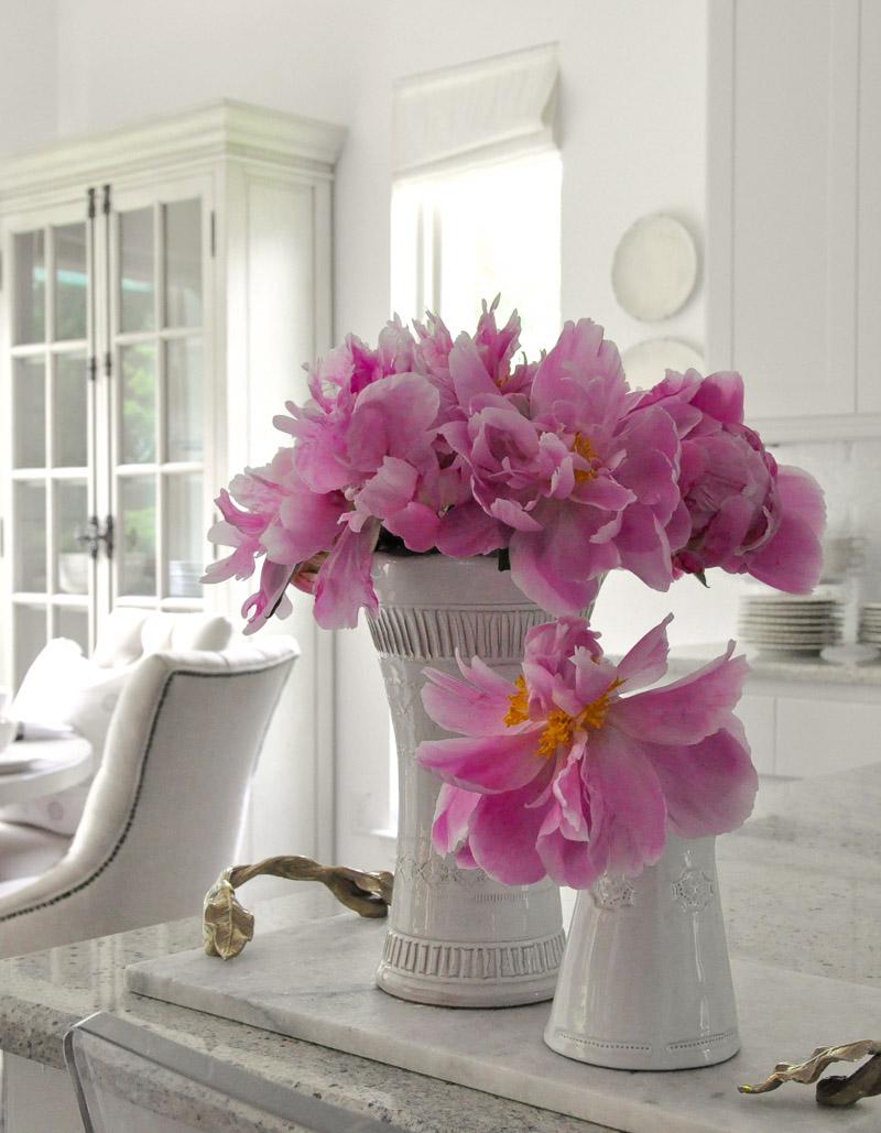 white vases bright pink peonies