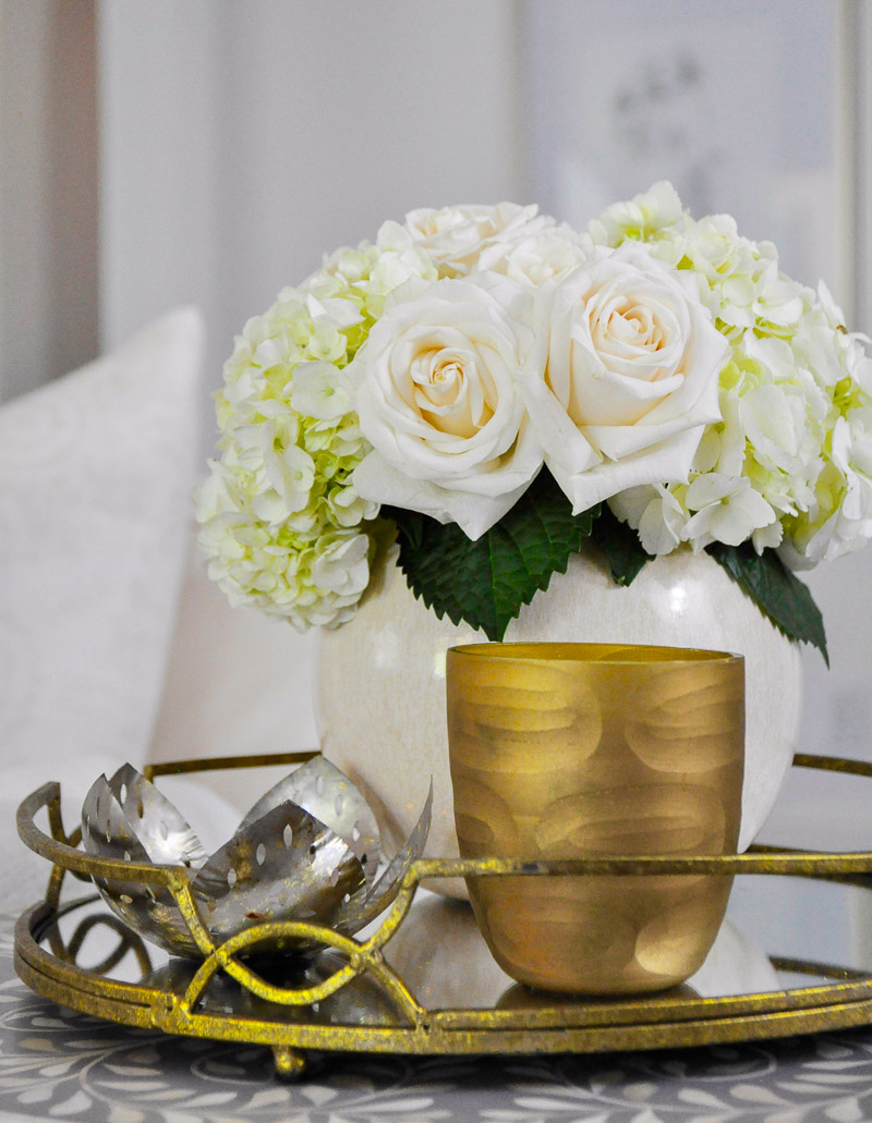 Gold tray home vignette