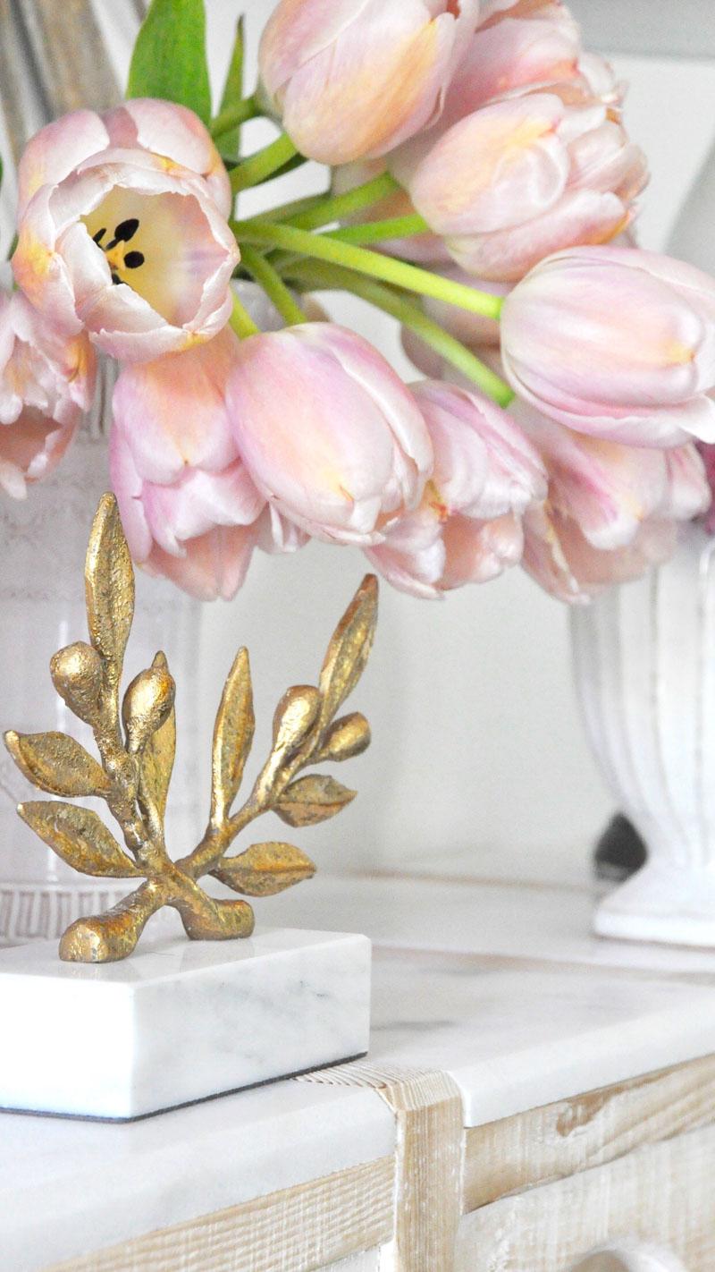 gold statue olive leaf