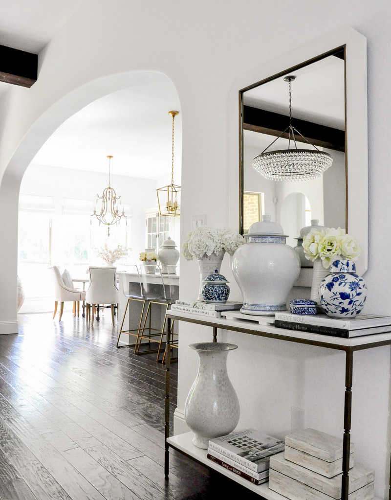 stylish entry hall console decorated ginger jars