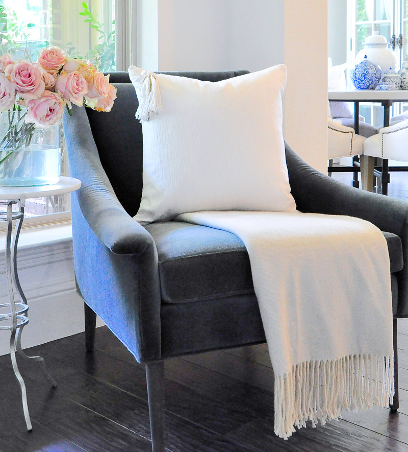 blue velvet chair white pillow tassel