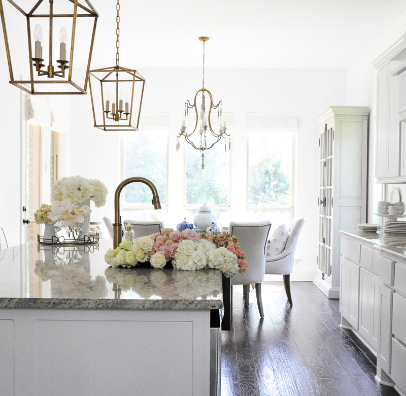 Beautiful white kitchen breakfast room gold accents
