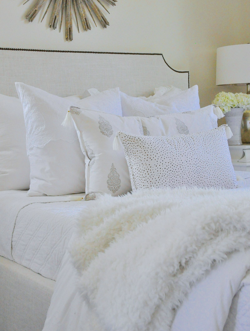 Beautiful white bedding adds style