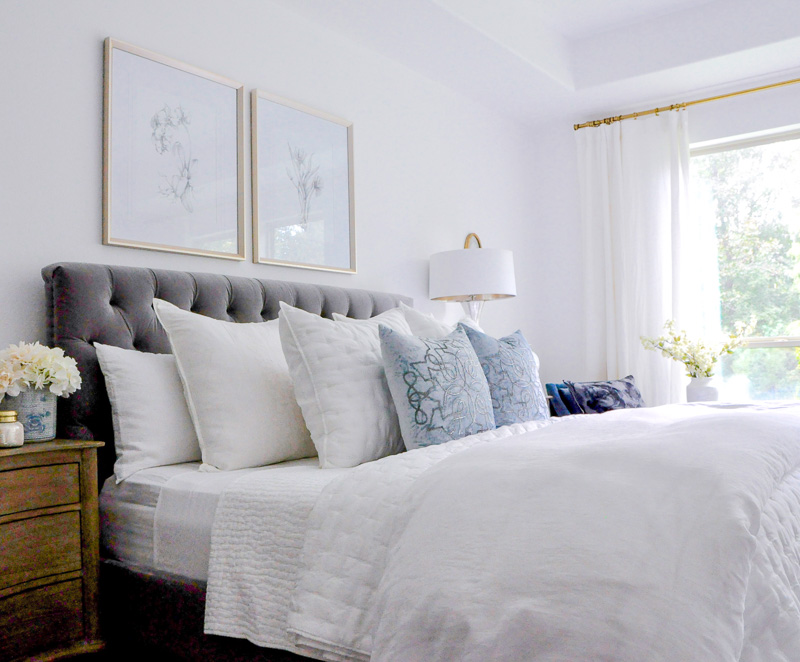 bedroom gray bed white bedding blue accents