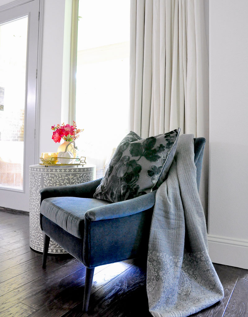 Blue velvet chair gray throw blanket