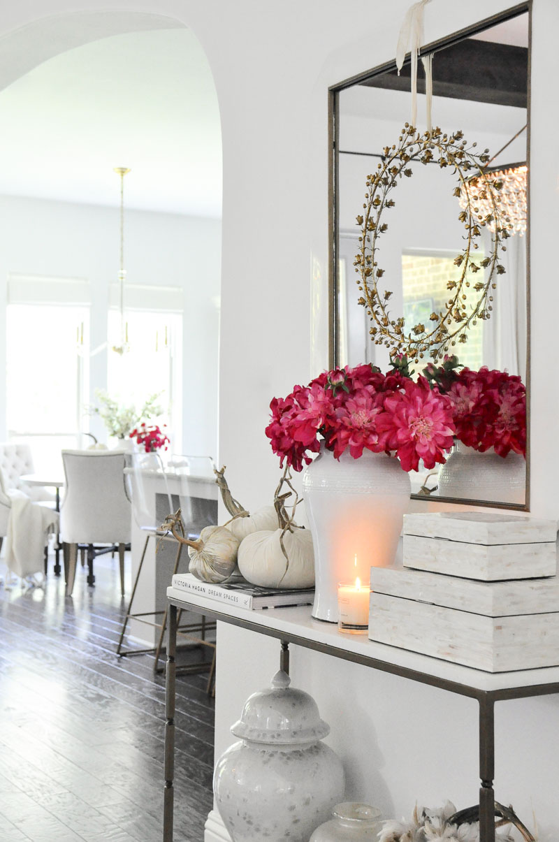Console table pink fall flowers white velvet pumpkins