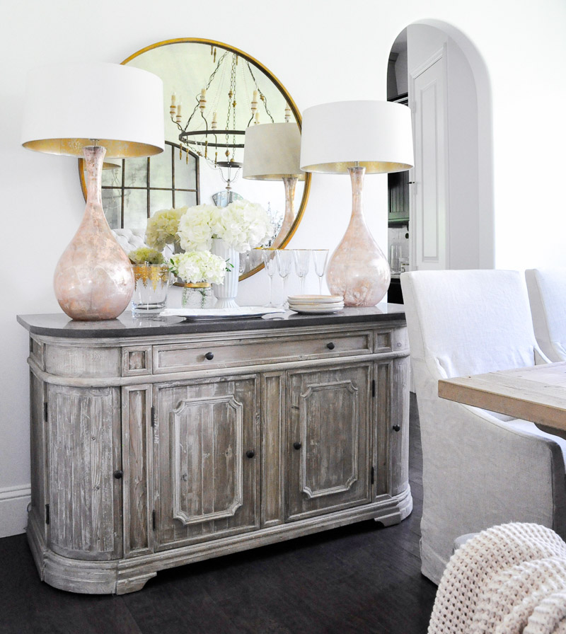 Dining room sideboard round mirror blush pink lamps