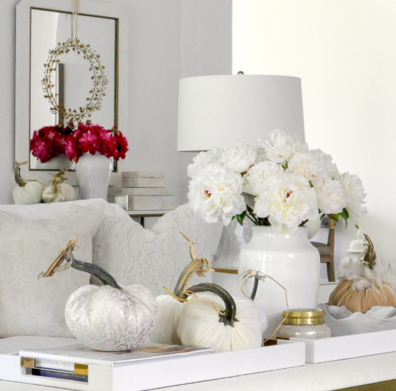Fall living room cozy white furniture velvet pumpkins