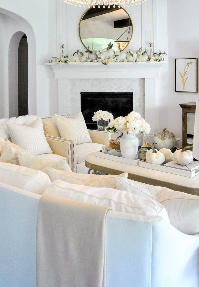 Fall living room white furniture mantel white pumpkins