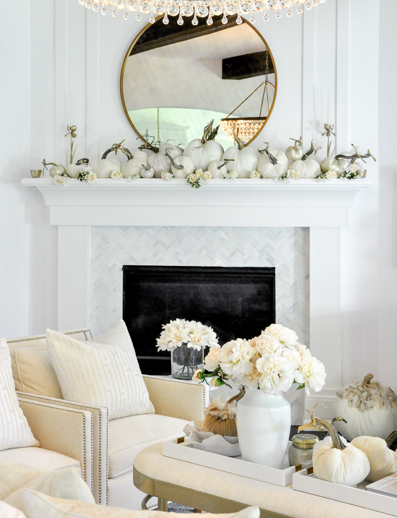 Fall living room white furniture beautiful fireplace surround velvet pumpkins