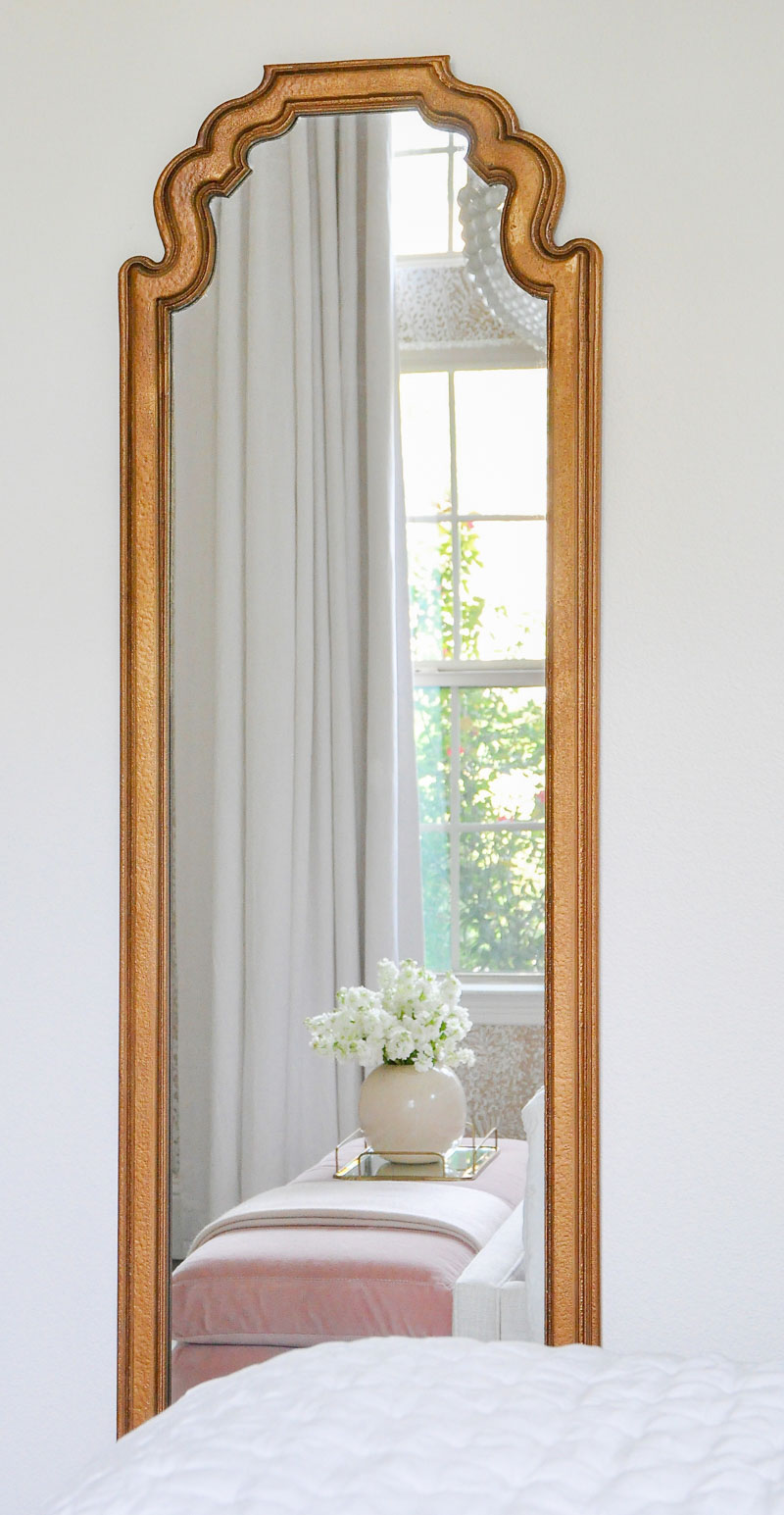 Gold framed guest bedroom mirror