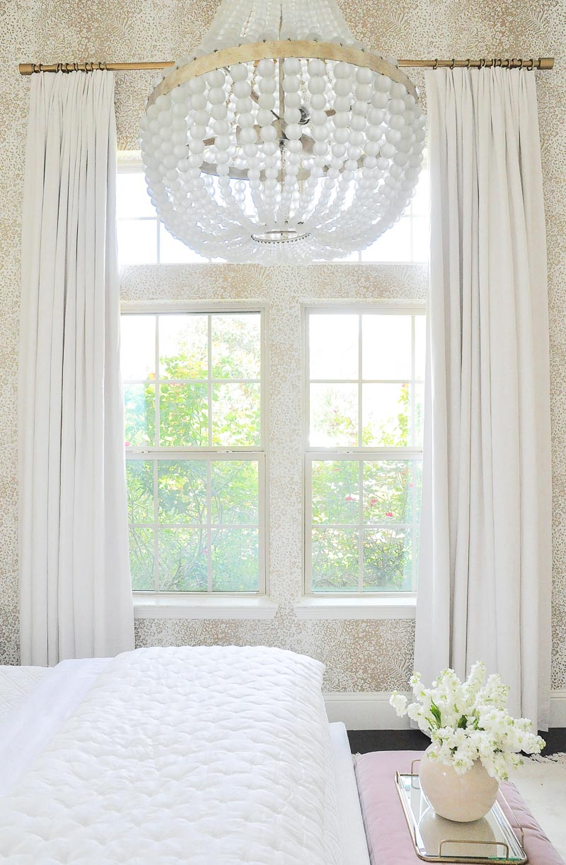 Guest room long white linen draperies