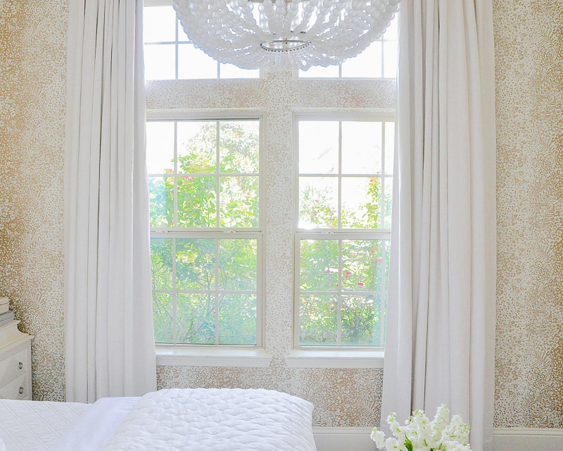 Guest bedroom elegant white draperies