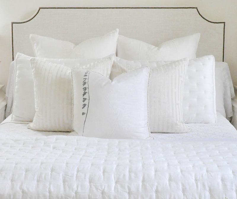 Dreamy bedroom overstuffed white pillows