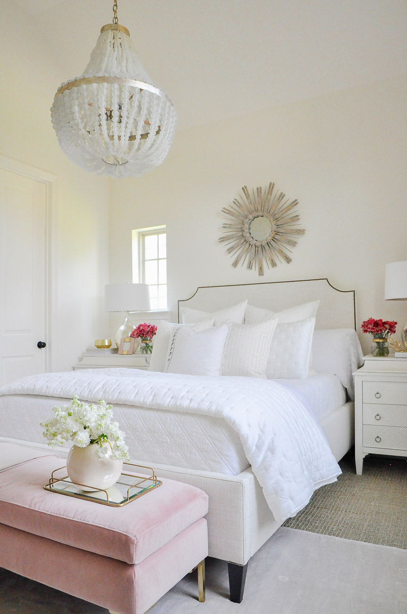 Beautiful white guest bedroom blush accents