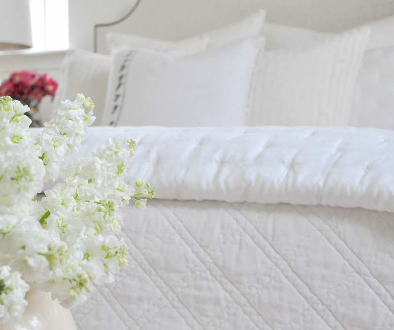 Beautiful cozy white bedding guest room
