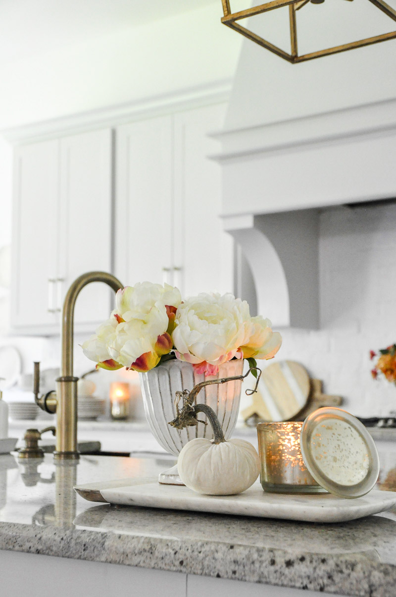 Kitchen brass faucet light gray cabinets