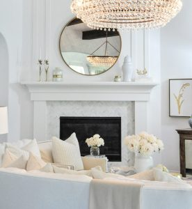 Living room white fireplace surround