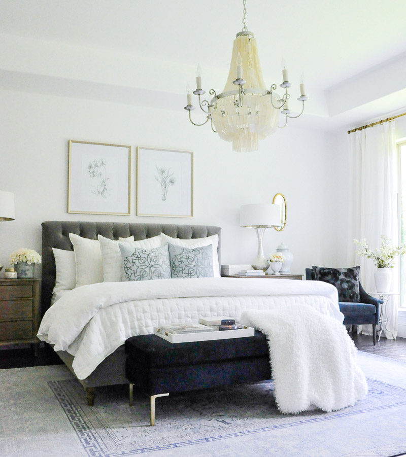 Master bedroom gray tufted bed white bedding