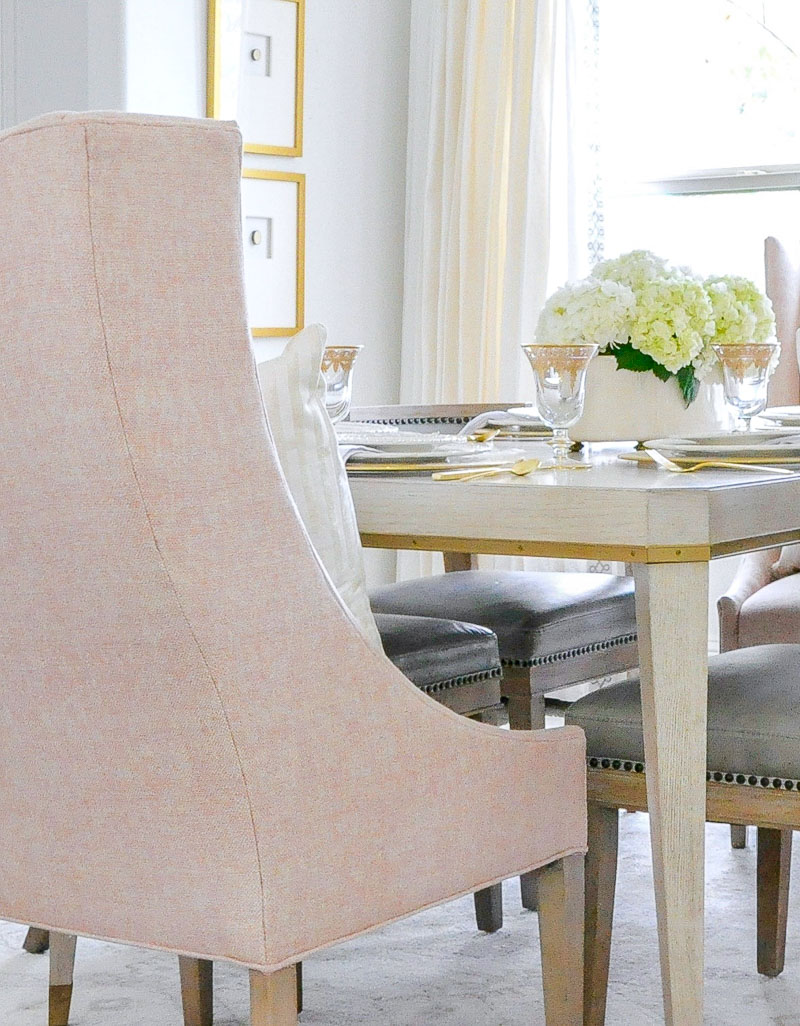 Bright inviting dining room blush chair