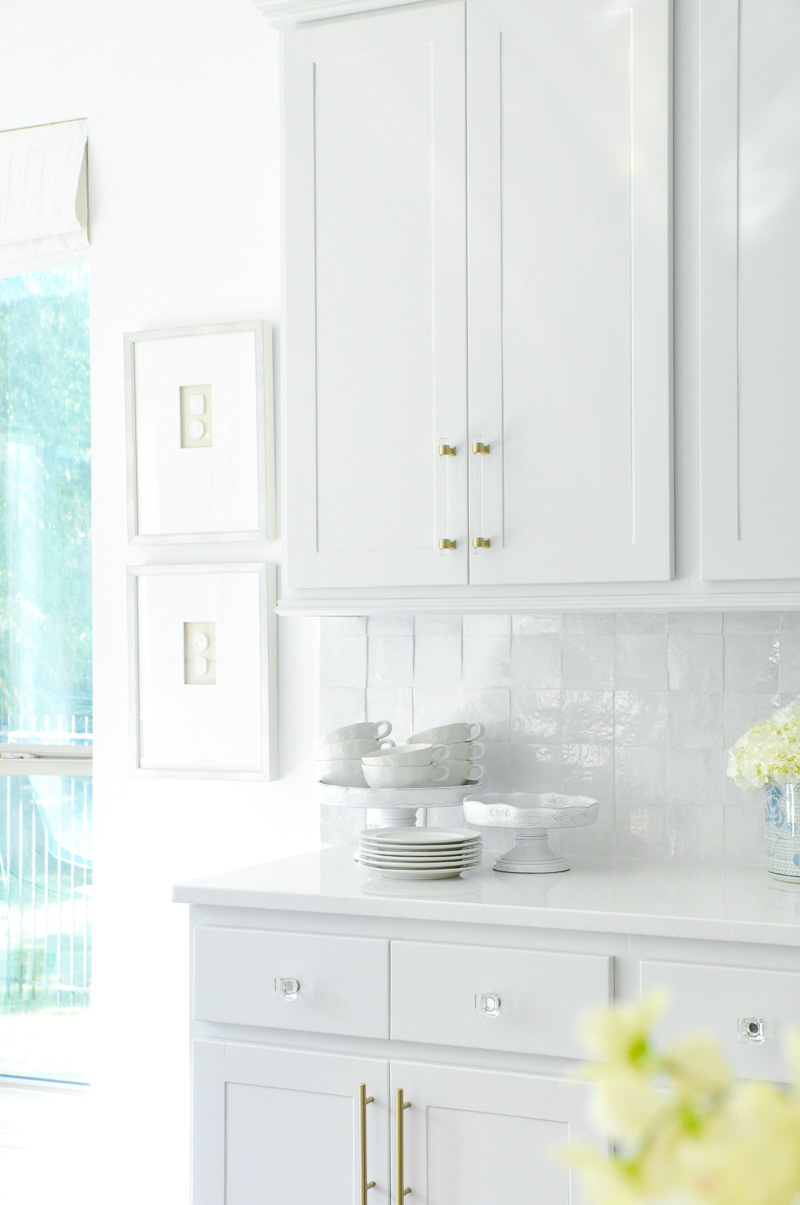 Light gray kitchen cabinets brass pulls