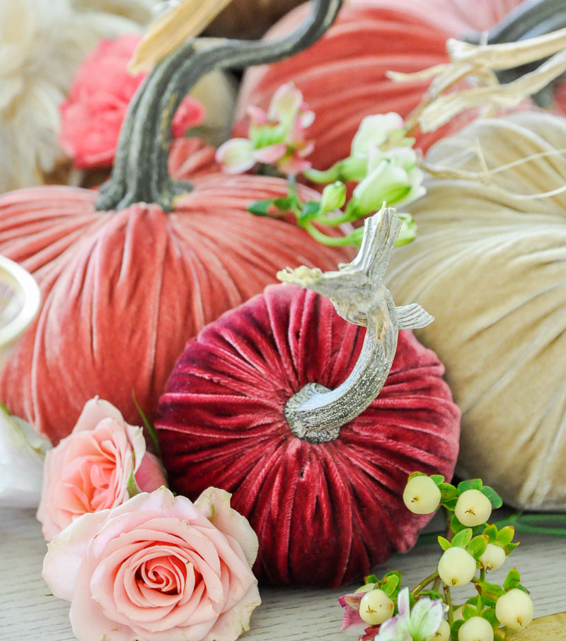 Thanksgiving centerpiece cascading pumpkins colors pinks reds