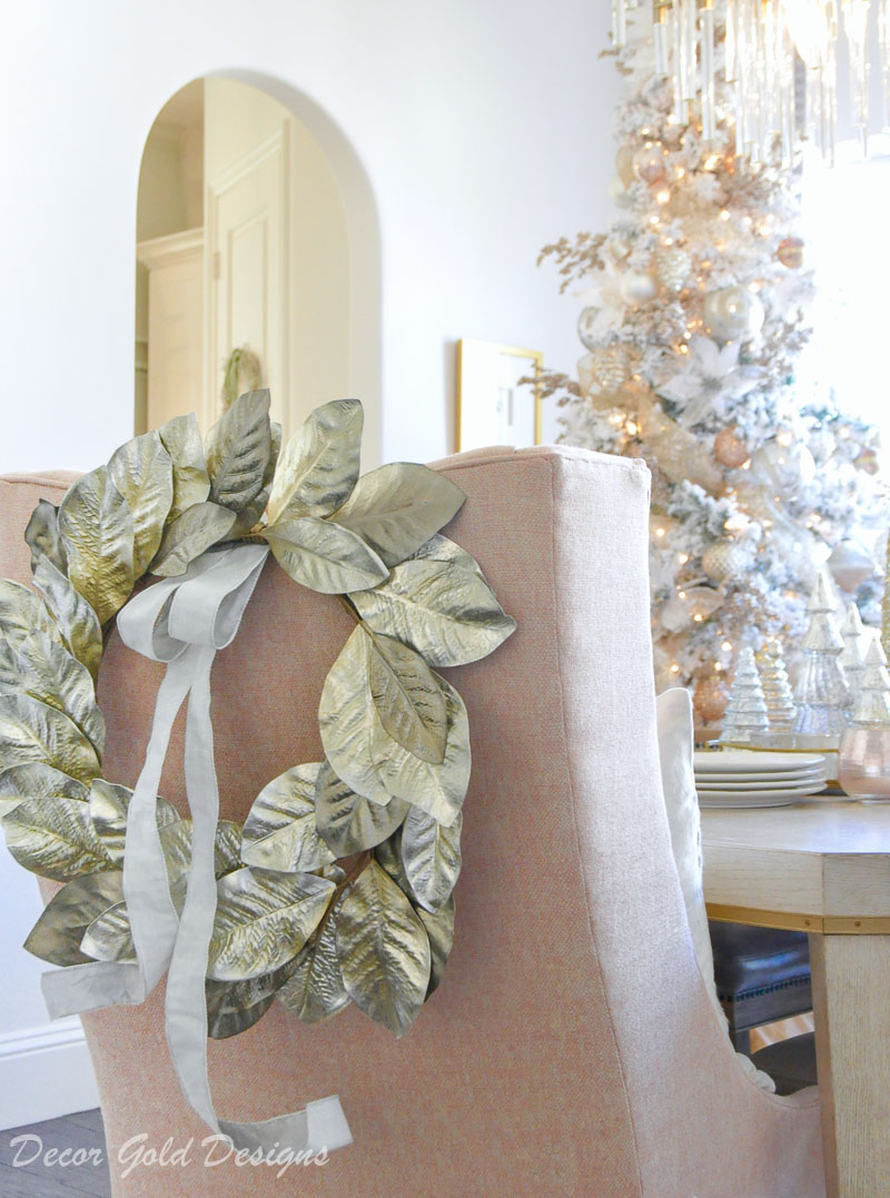 Christmas home tour dining room blush chairs gorgeous gold chair back wreath