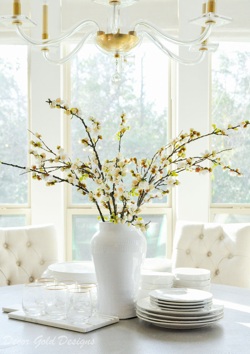 breakfast nook round table vase full branches