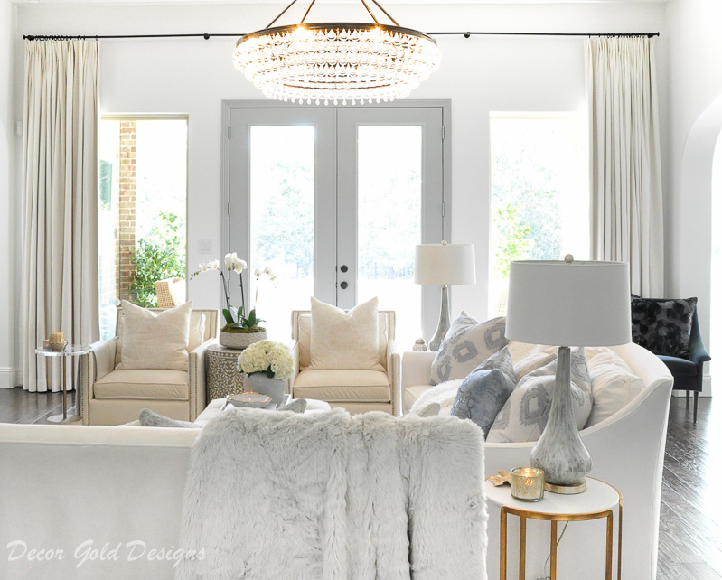 cozy living room white gray beautiful doors chandelier