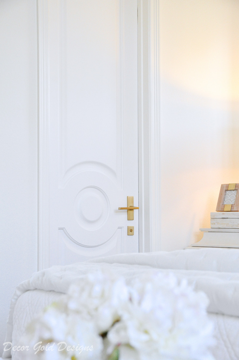 beautiful bedroom white door brass lever