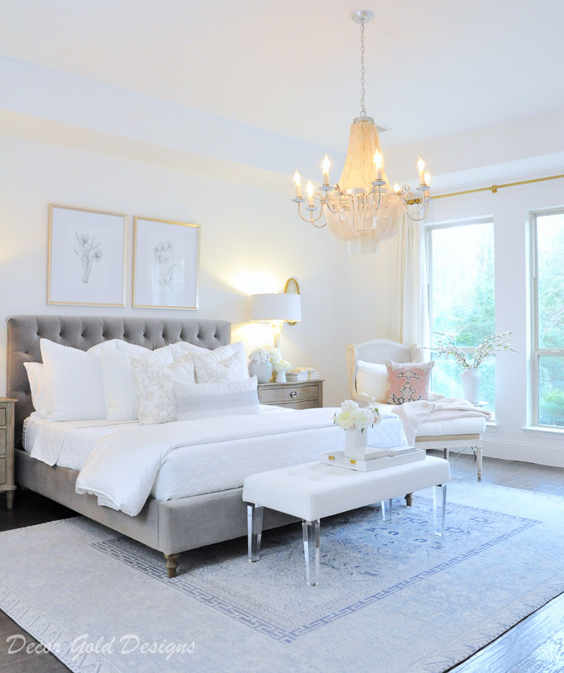bedroom white bedding gray bed blue rug