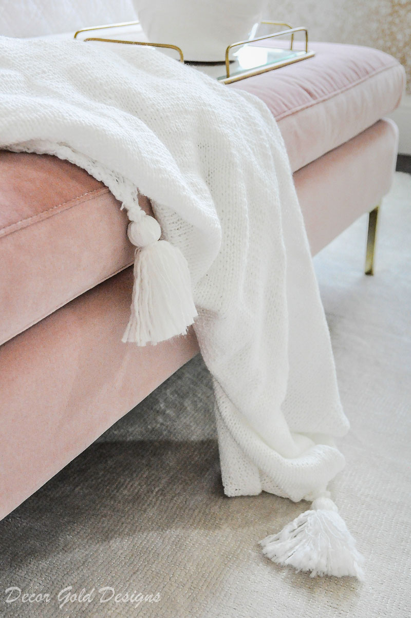 Tassel throw blanket pink bench