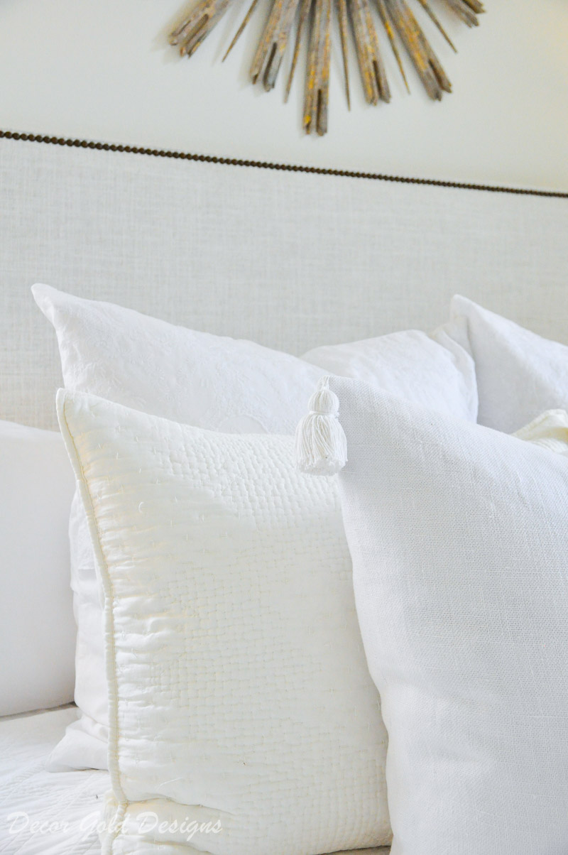 white bed pillows tassels