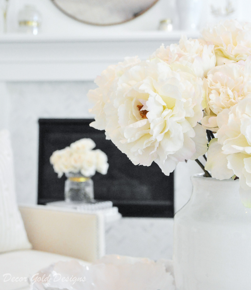 faux flowers beautifully styled white vase