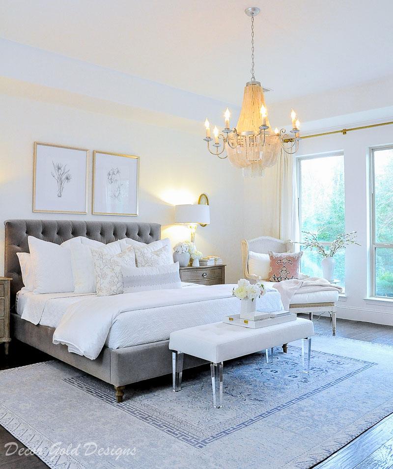 Bedroom gray tufted bed chandelier