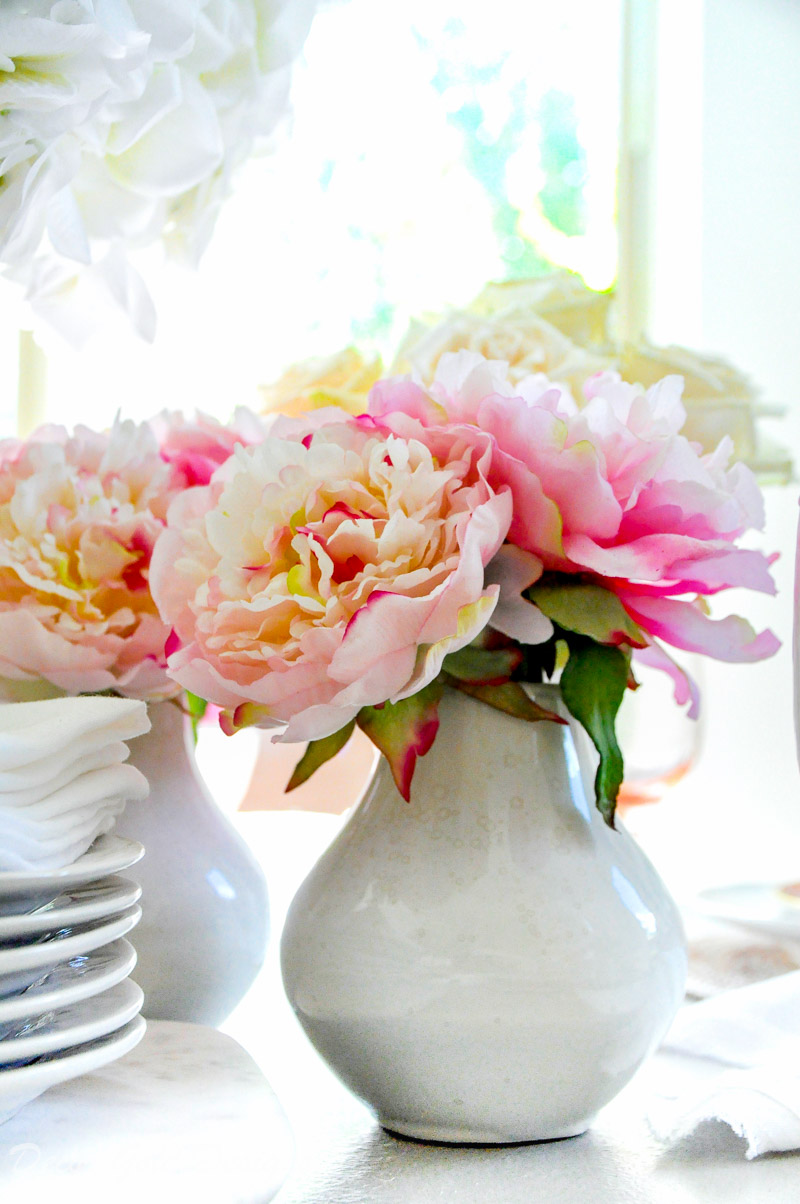Beautiful faux flowers pink peonies white vase