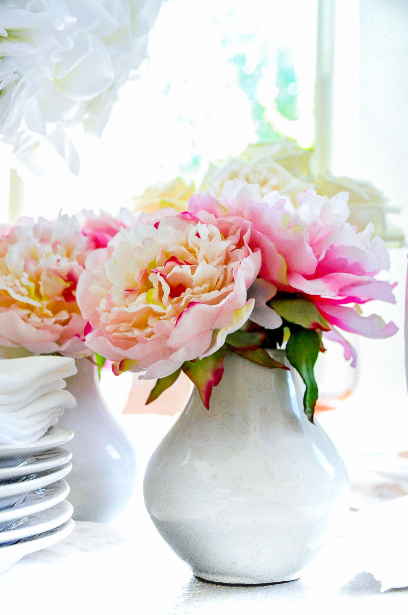 Beautiful faux flowers pink peonies white vase